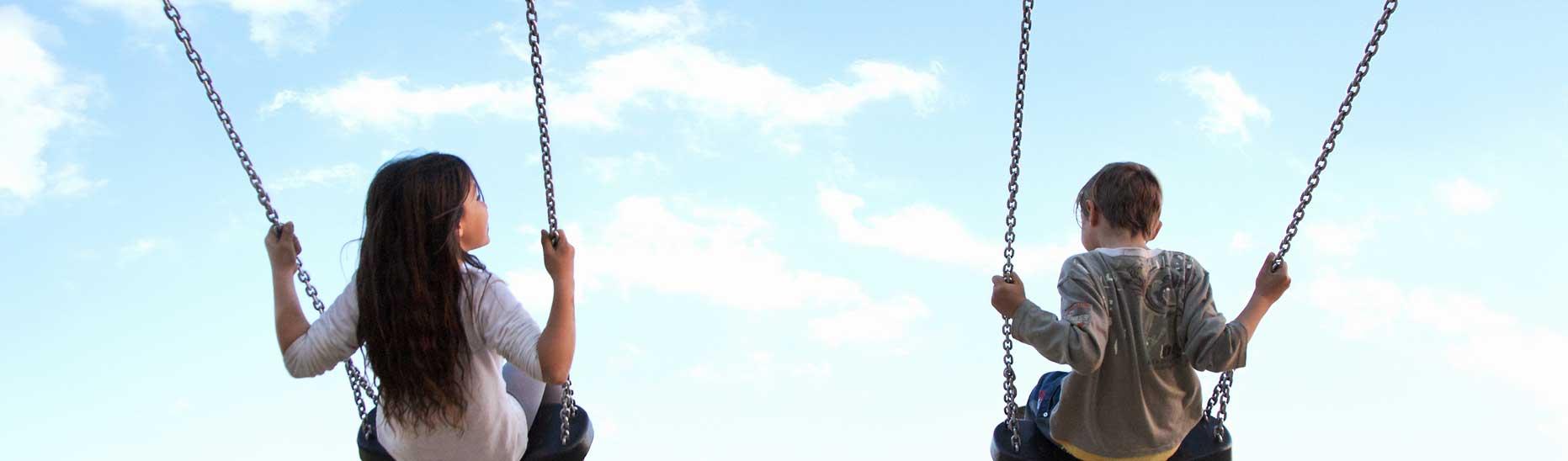 2 kids on swings